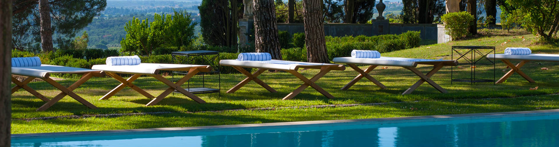 Villa Taverna, Tuscany|At the turn of the rolling hills of Chianti, in the land of the finest wines, a villa overlooking the charateristc vineyards, olive groves and small villages.